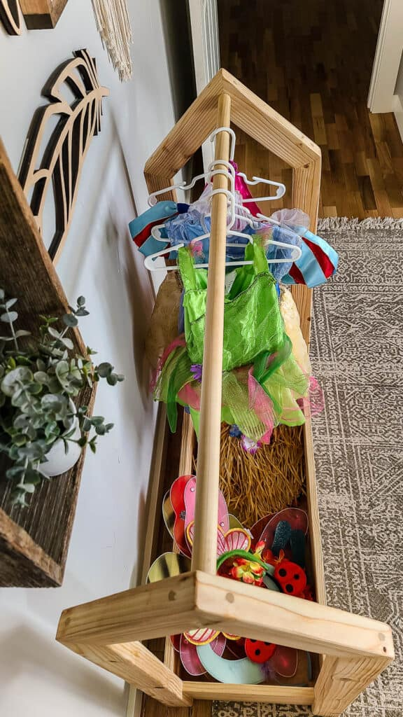 Top view of the DIY wooden dress up storage rack with costumes and accessories