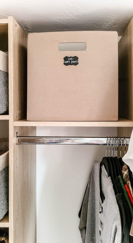 Basket organization above hanging rod in master closet