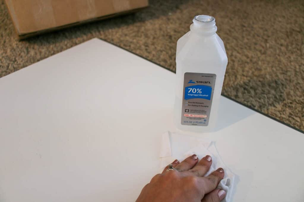 applying rubbing alcohol to the back of wall panels