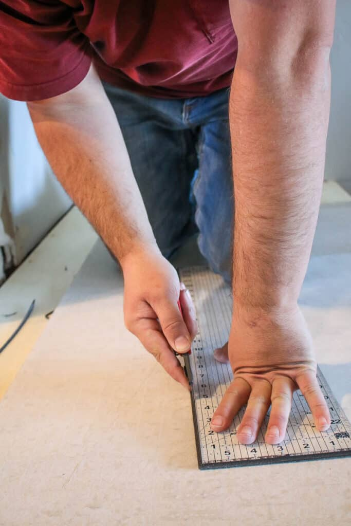 Trimming wall panels with a utility knife