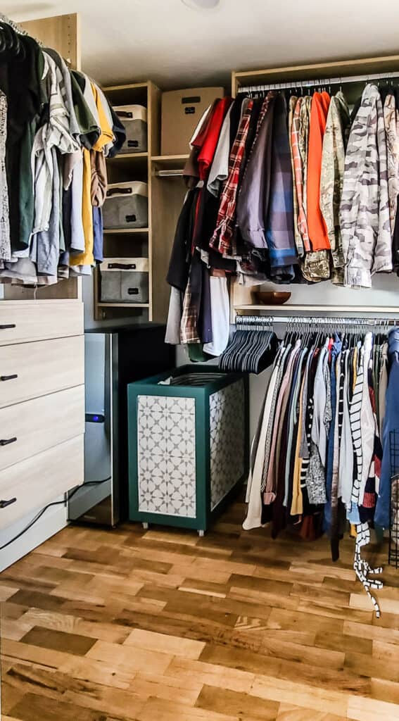 Clothes hanging and storage in small walk in master closet