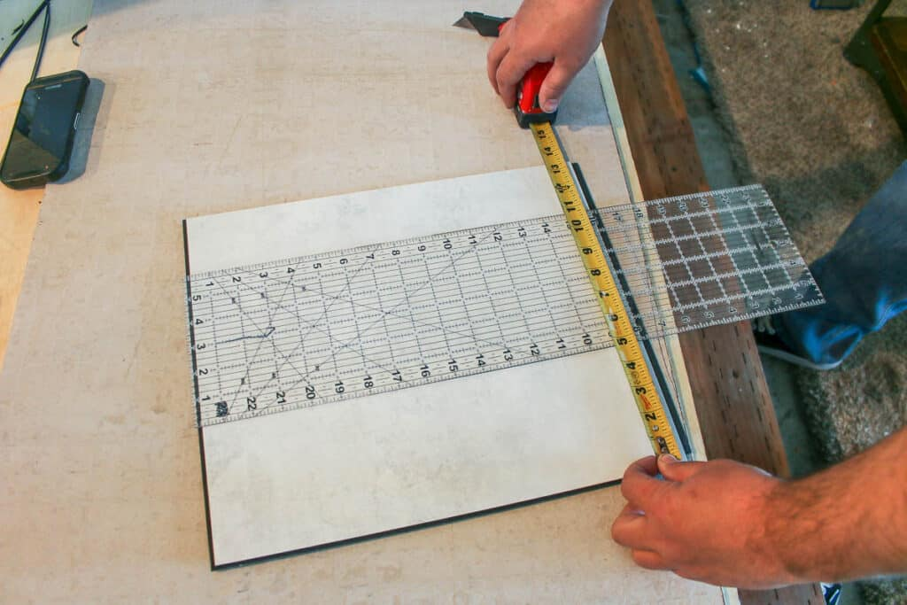 measuring and trimming wall panels with a utility knife