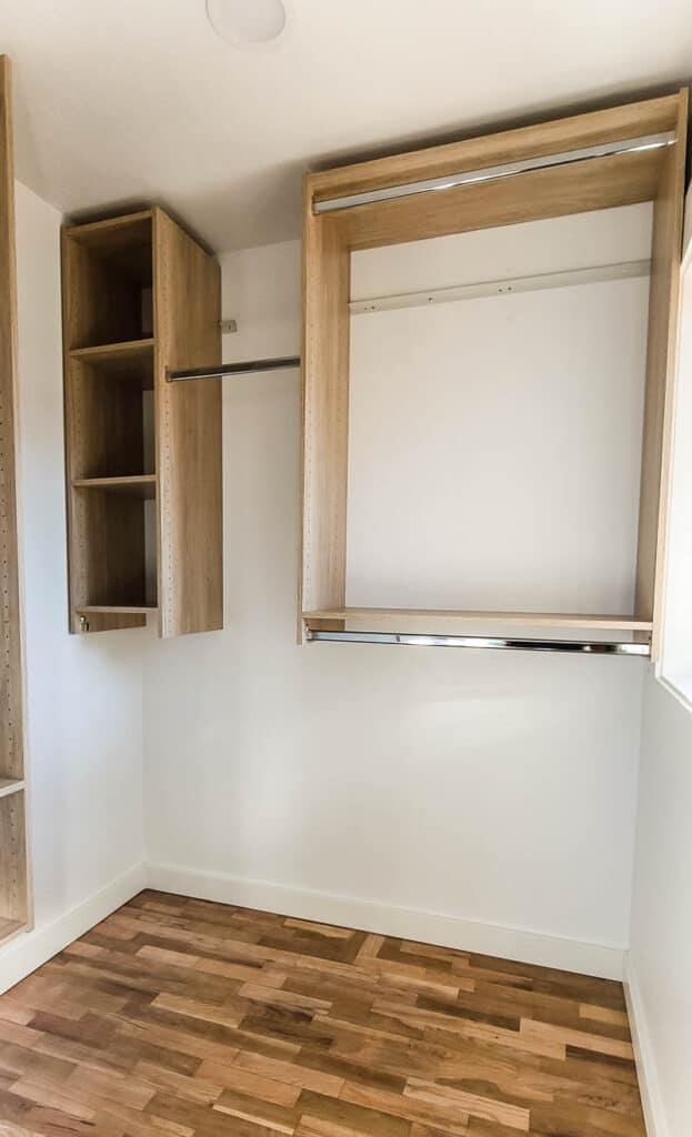 Wooden wall organization system for closet in empty closet