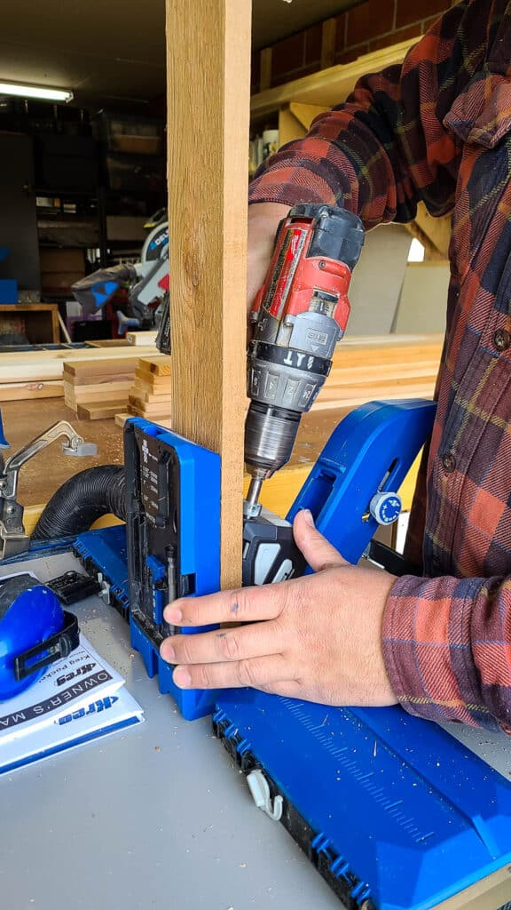 Man drilling pocket hole with Kreg720 pro for outdoor fire wood storage rack