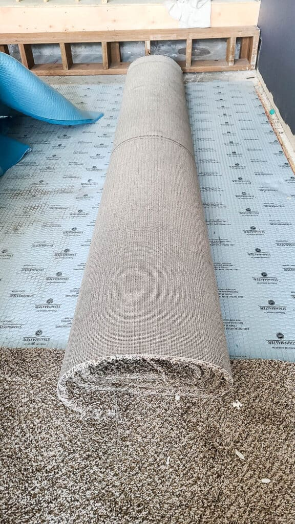 roll of old carpet with carpet padding