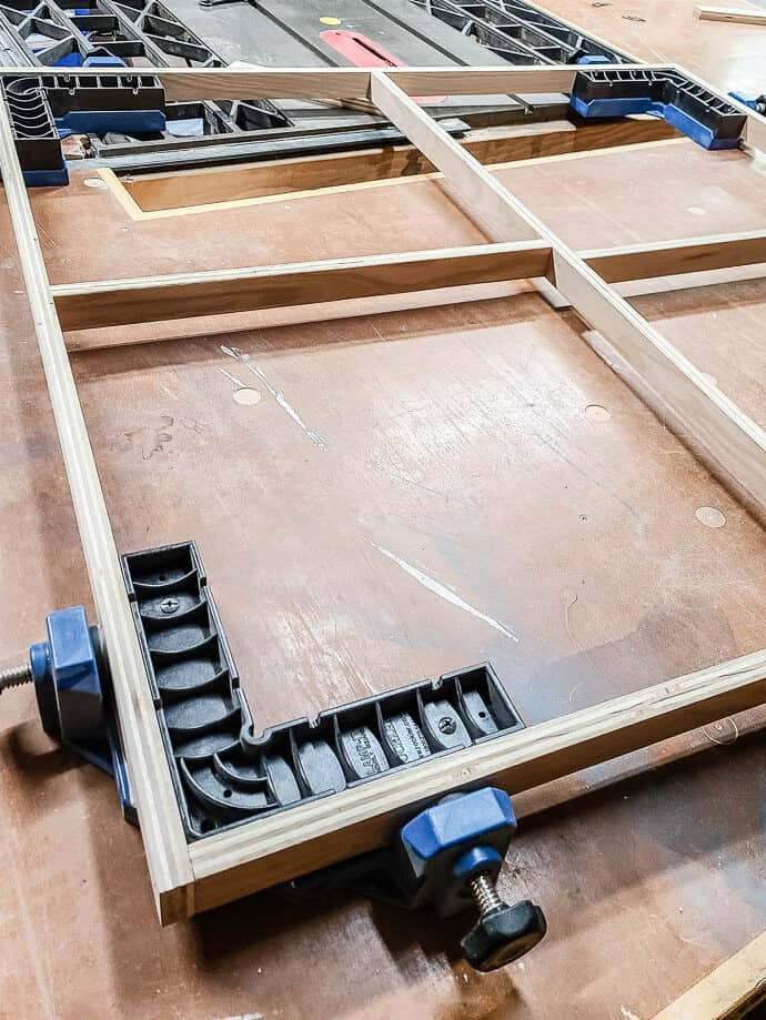 Attaching the edges of the wood frame for fabric wall art using corner 90 degree clamps