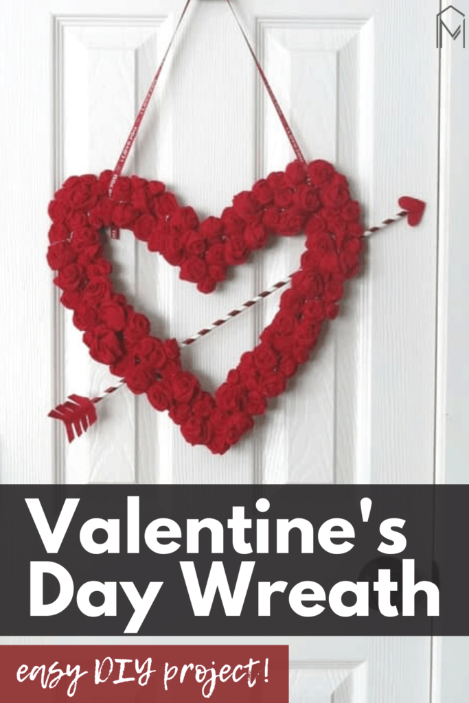 Valentine's Day wreath hanging on the door with text overlay that says Valentine's Day Wreath & Easy DIY wreath