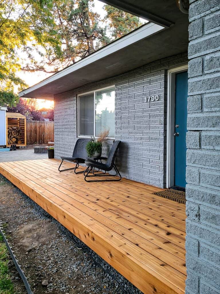 After view of the backyard with wood deck