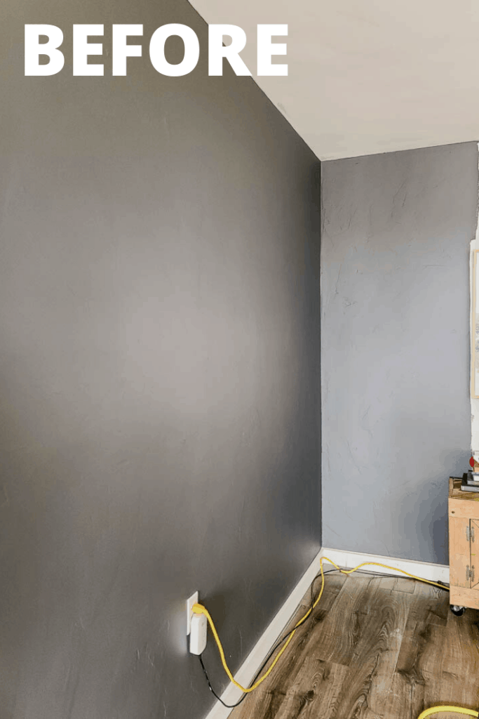 Gray wall before the wood slat accent wall makeover