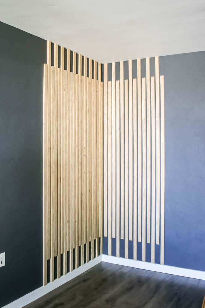 Wood slat accent wall in the corner after the makeover