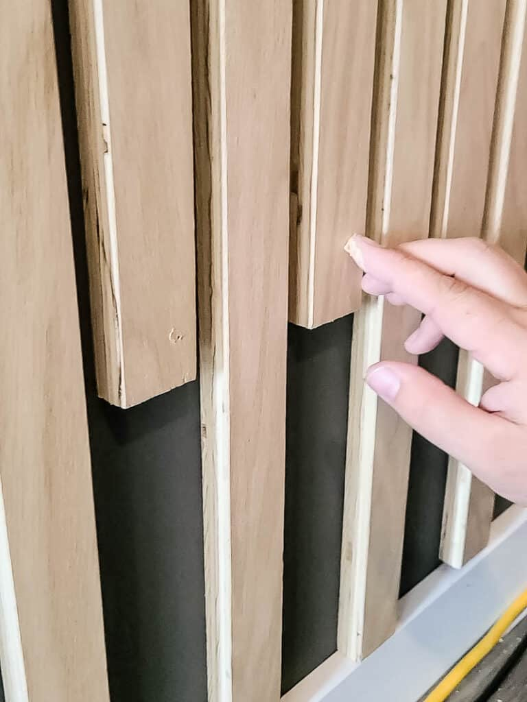 Filling nail holes on the wood slats with wood filler
