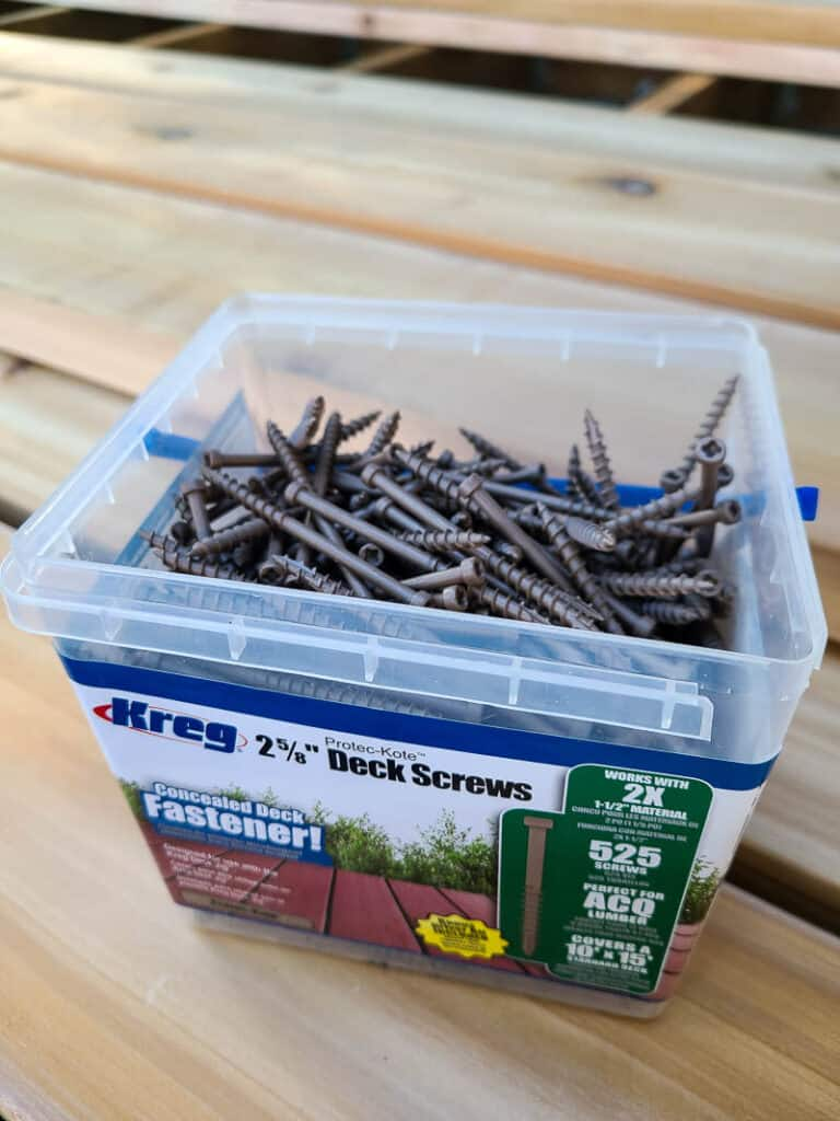 Kreg screws in container on top of the wood deck boards