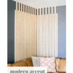 This DIY slat wall makes a big impact and was easy to create! Learn how to install a modern vertical wood slat wall in your home!