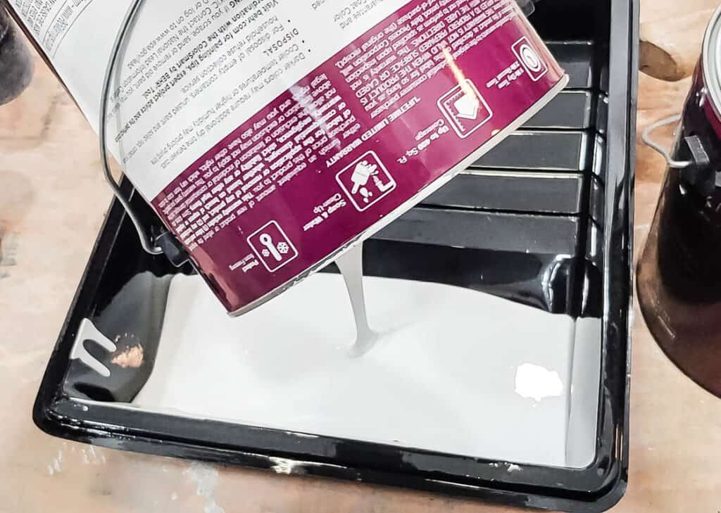 Carefully pour the wall paint color into a paint tray. Grab your paint roller, 3/8