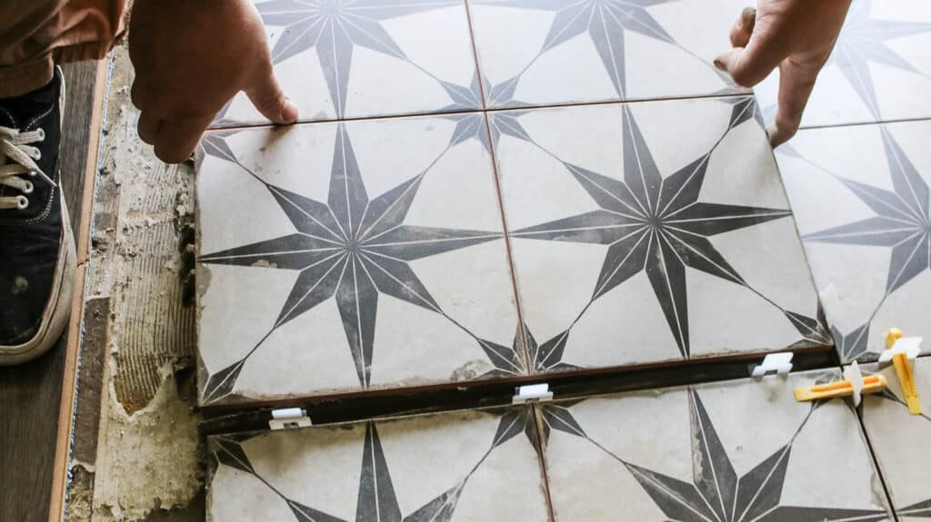 Laying floor tile in the middle of other already attached tiles