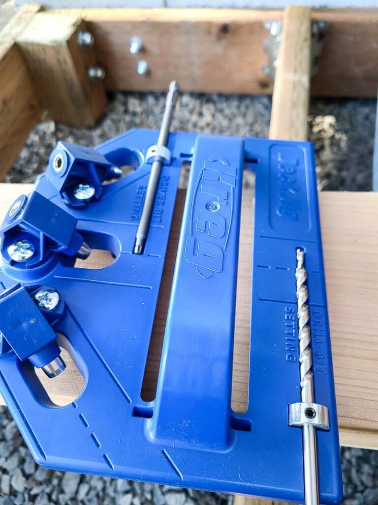 Close up of the deck jig getting the driver bit and drill bit stop collars on