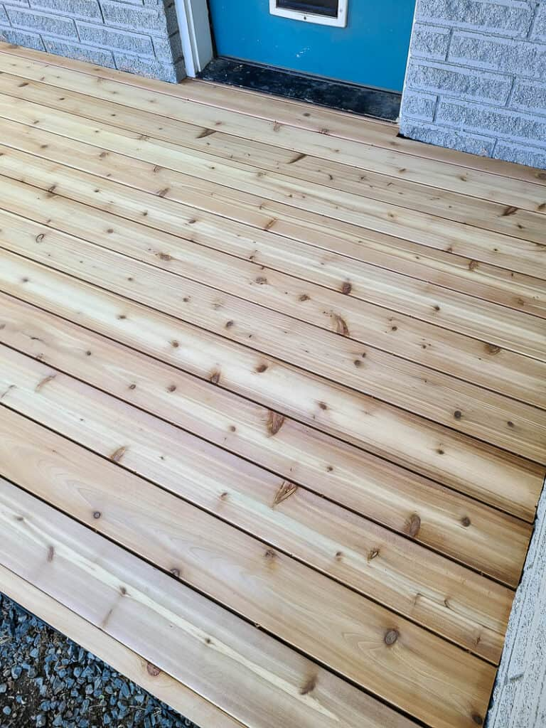 Close up of the backyard with wood deck board attached