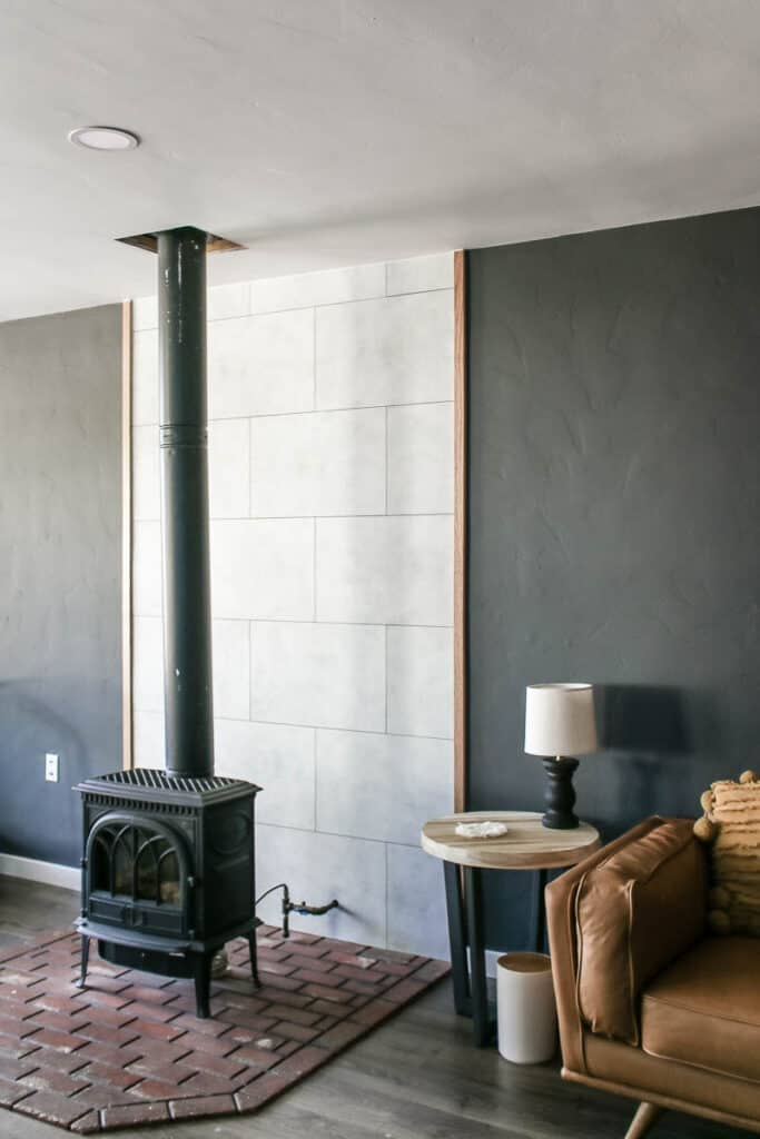 The fake concrete wall panels look amazing and add tons of modern industrial style to our living room fireplace wall.