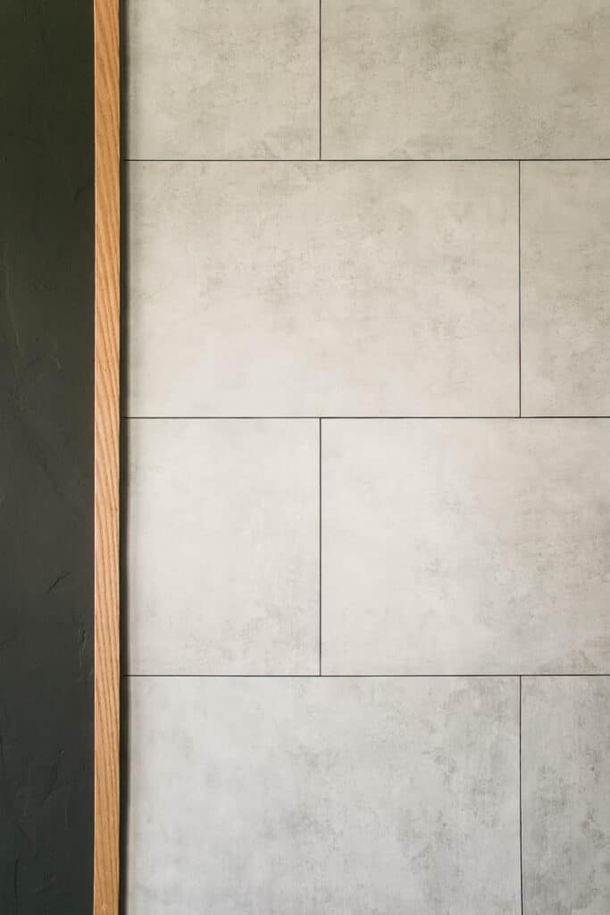 The faux concrete wall panels from Innovera Decor by Palram were so easy to use and look great! I love the modern industrial style they add to our living room fireplace wall.