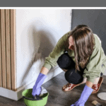 Woman wearing gloves dipping a cloth on a green bowl with text overlay that says how to clean walls before painting