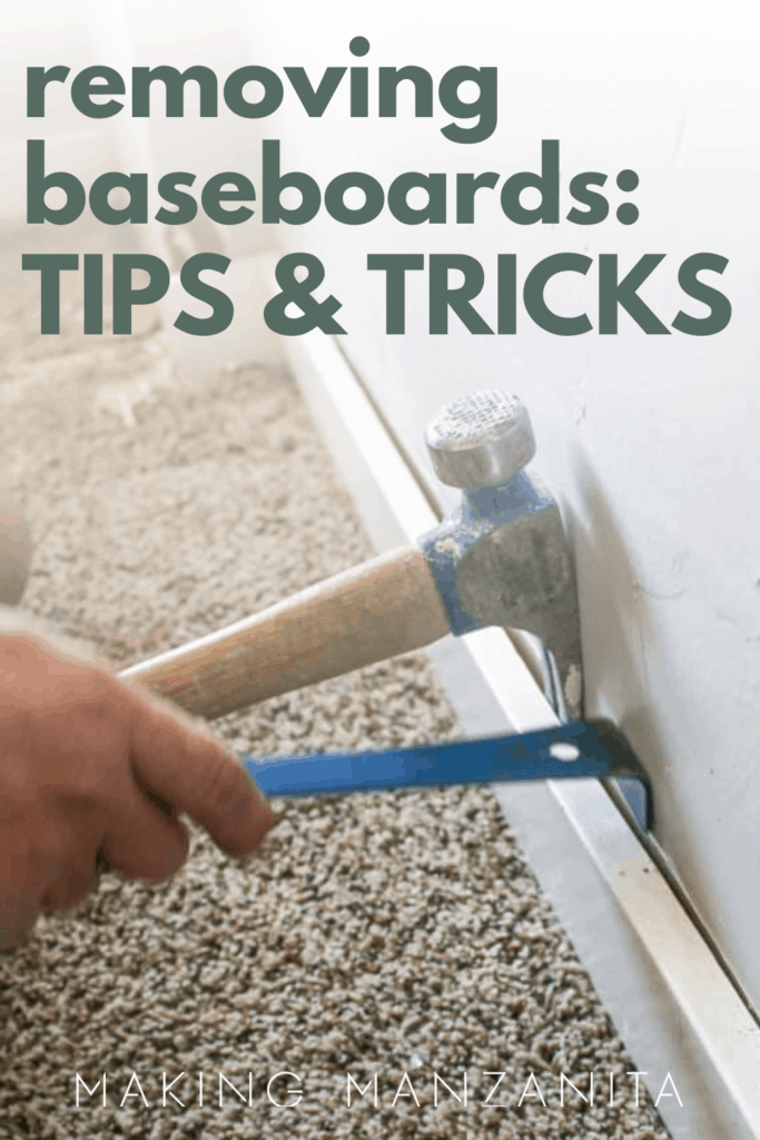 Man taking off off baseboard with a hammer using leverage with text overlay that says removing baseboards: tips & tricks