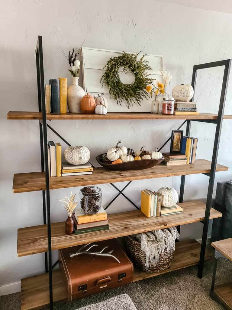 side angle of bookshelf with fall decor