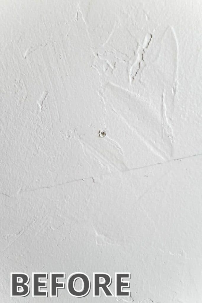 White wall with nail hole showing before image