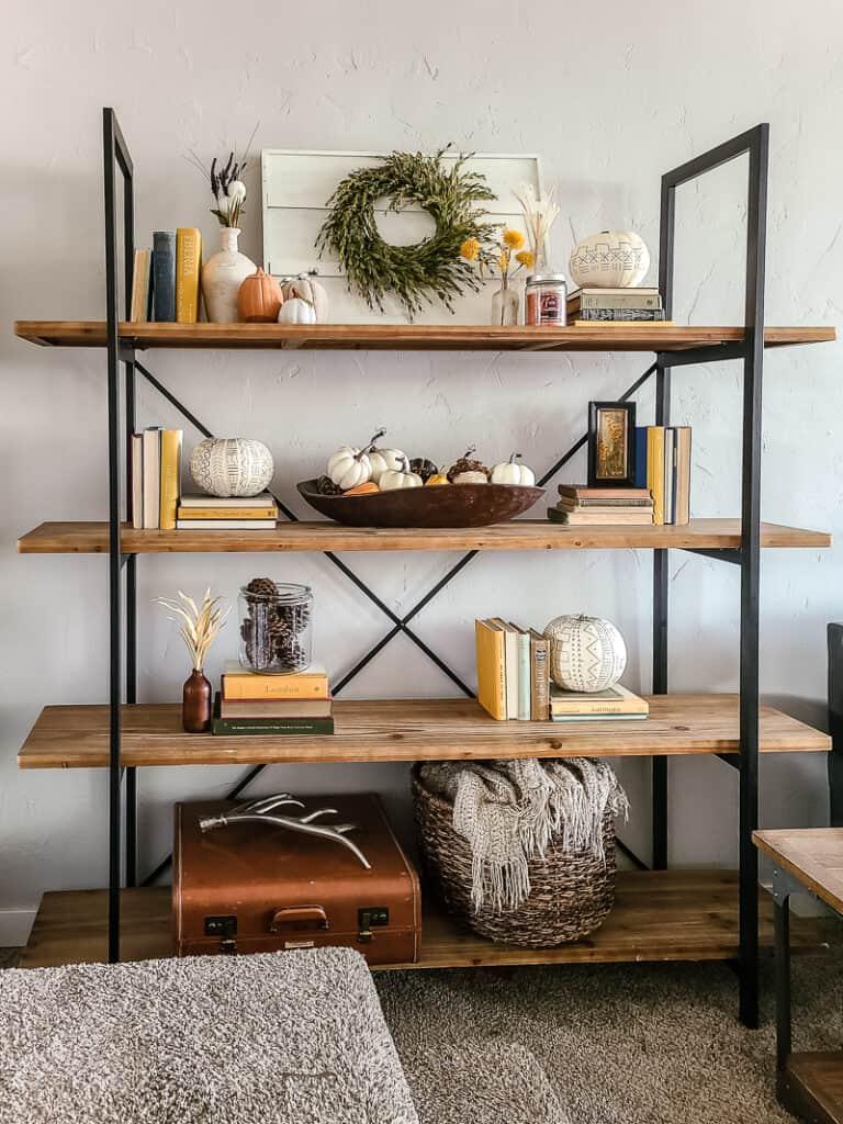 bookshelf with fall decor