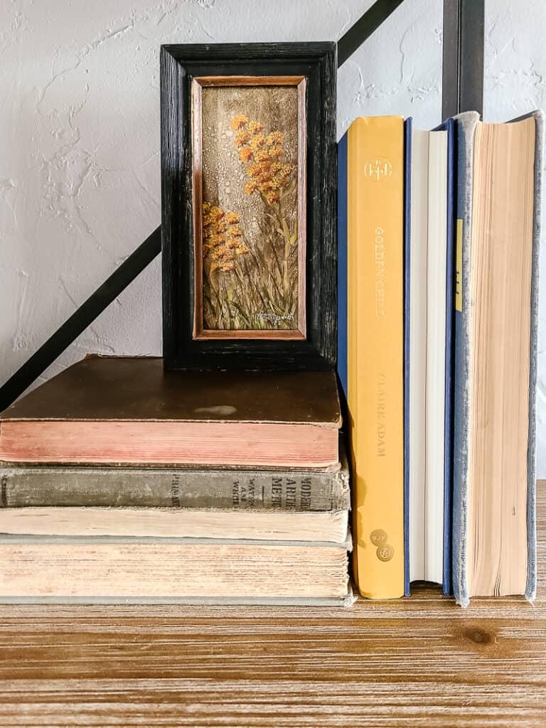 art and books displayed on shelf