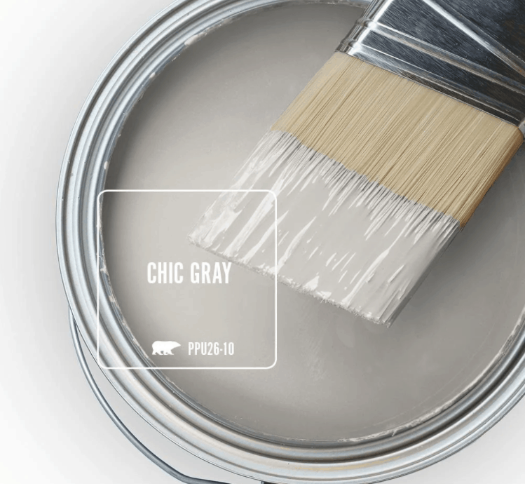 Behr chic gray paint color in can and a paint brush dipped in it