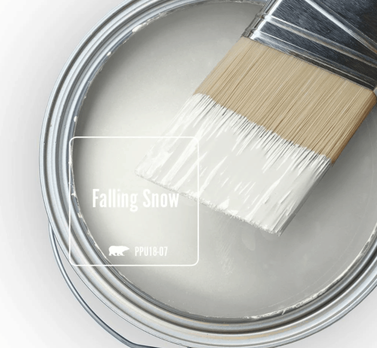 Behr falling snow paint color in can and a paint brush dipped in it