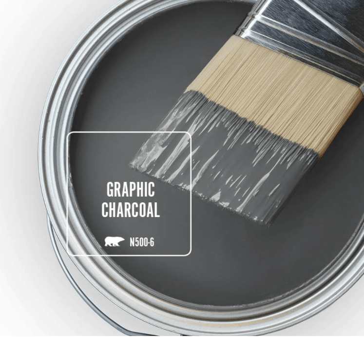 Behr graphic charcoal paint color in can and a paint brush dipped in it