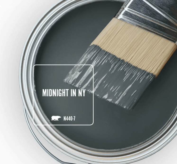 Behr midnight in NY paint color in can and a paint brush dipped in it